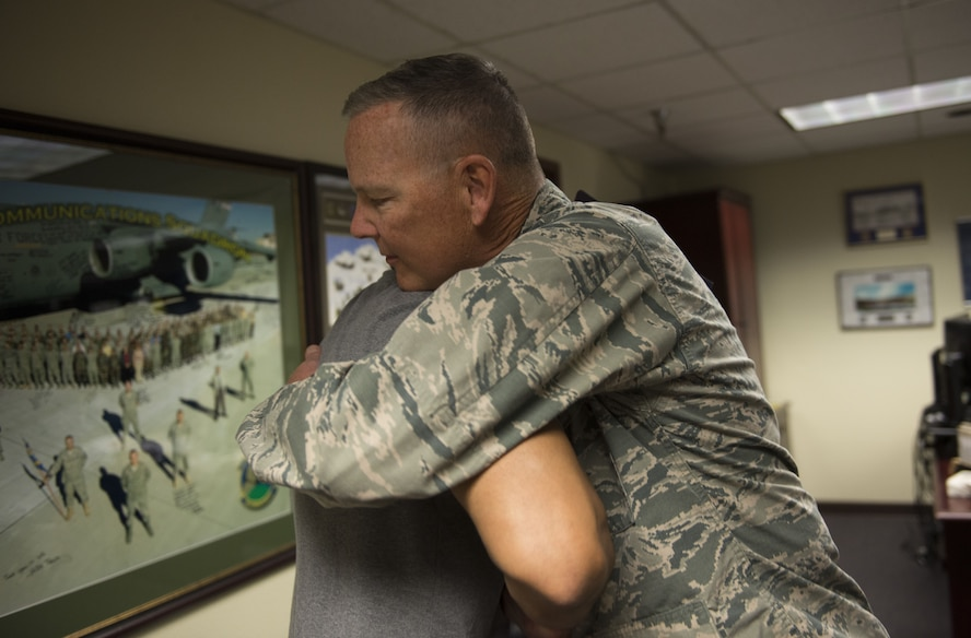 Col. Robert Sylvester, 56th Mission Support Group commander, hugs Mitchell Malloy, Gold Star family member, at Luke Air Force Base, Ariz., Feb. 2, 2018. Malloy became a Gold Star family member after his father, Maj. Jeffrey Ausborn, was killed in 2011 while deployed in support of Operation Enduring Freedom. (U.S. Air Force Photo/Airman 1st Class Alexander Cook)