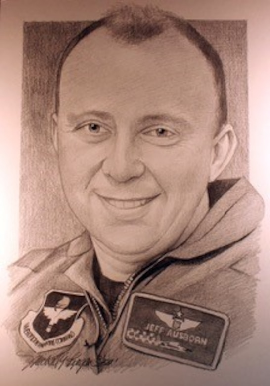 """Maj. Jeffrey """"Oz"""" Ausborn, 41, was among nine Airmen killed when a shooter opened fire in the Kabul International Airport April 27, 2011 in Afghanistan. Ausborn voluntarily deployed for a one-year assignment in support of Operation Enduring Freedom training Afghan pilots to become aircrew members for the C-27 Spartan aircraft. As a senior pilot, Ausborn logged more than 2,300 hours in both airlift and trainer aircraft, to include the T-37B, T-44, C-130E, T-6A, T-1A and C-27. (Courtesy photo)"""