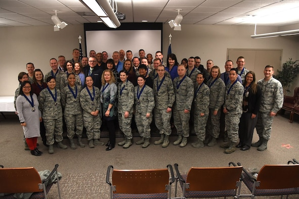 PETERSON AIR FORCE BASE, Colo. – 21st Space Wing Annual Award nominees pose for a group photo with Col. Todd Moore (Left), 21st SW commander and Chief Master Sgt. Mark Bronson (Right), 21 SW command chief at the Annual Award Medallion Ceremony on Peterson Air Force Base, Colorado, Feb. 5, 2018. The winners were announced at the Annual Award Ceremony Feb. 6. (U.S. Air Force photo by Robb Lingley)