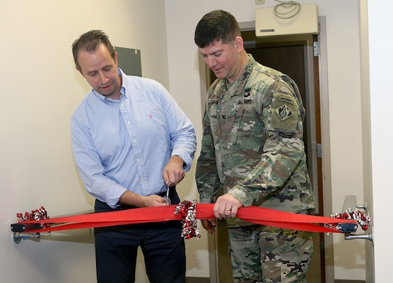 ACE-IT Chief Herman Kramer (left) and Savannah District Commander Col. Marvin Griffin (right) cut  ribbon celebrating the completion of a new Information Technology Helpdesk Jan. 31.