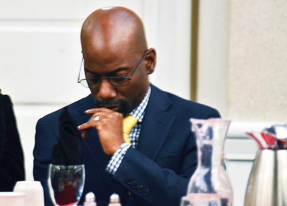 Senior Pastor Paul Graham of the Restoration Praise Center in Bowie, Maryland, was invited as the keynote speaker. Graham prays for words of wisdom before addressing guests of the 18th annual prayer breakfast at THe Clubs at Quantico.