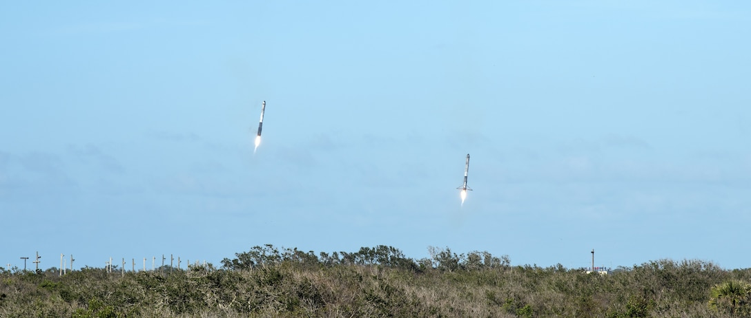 Two boosters from SpaceX's Falcon Heavy rocket approach Landing Zones 1 and 2, located at Cape Canaveral Air Force Station, Fla. on Feb. 6, 2018. The rocket, which lifted off from the historic launchpad 39A at NASA's Kennedy Space Center, is now the most powerful launch vehicle in operation anywhere in the world. (U.S. Air Force photo by Airman Zoe Thacker)