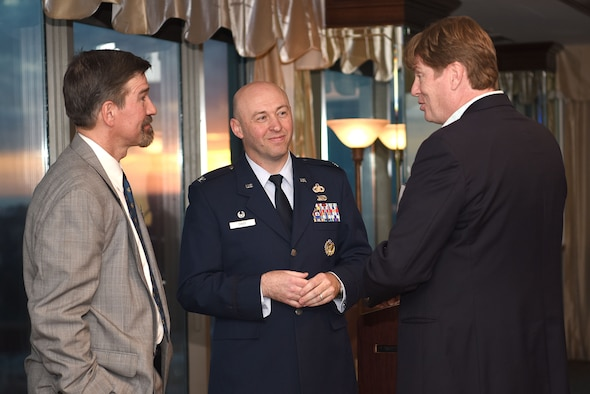 Bill Lavers, Harrison County Development Commission executive director, right, speaks with Col. Danny Davis, 81st Mission Support Group commander, middle, and Charles Eastman, Million Air Gulfport-Biloxi general manager, left, during the Mississippi Coast Foreign Trade Zone dinner at The Great Southern Club, Jan. 31, 2018, in Gulfport, Mississippi. The FTZ No. 92 was established in 1983 and is made up of different companies that contribute to the Mississippi Gulf Coast economy. The annual gathering enables executives and board members of the various public entities and individual zone users an opportunity to come together in one place at the same time to learn more about zone-related activities and issues, and to hear from a guest speaker about other community-related activities, or FTZ and trade-related topics. As the guest speaker, Davis highlighted Keesler's community partnerships as well as the increasing economic impact the base has on the Mississippi Gulf Coast economy. (U.S. Air Force photo by Airman 1st Class Suzanna Plotnikov)