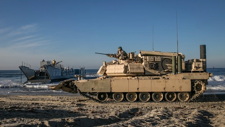 U.S. Marines from 1st Combat Engineer Battalion, 1st Marine Division, prepare to load an Assault Breacher Vehicle onto a Landing Craft Utility at Camp Pendleton, California. All vehicles were loaded onto LCUs then transported to the USS Rushmore to conduct the first amphibious landing in an ABV with a Modified Full Width Mine Plow prototype. Marine Corps Systems Command tested the prototype which will make it easier to transport the ABV from ship to shore.