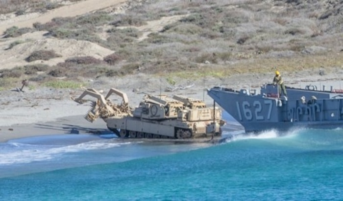 U.S. Marines from 1st Combat Engineer Battalion, 1st Marine Division, conduct the first amphibious landing in an Assault Breacher Vehicle with a Modified Full Width Mine Plow prototype during Exercise Steel Knight on the west coast. Marine Corps Systems Command tested the prototype which will make it easier to transport the ABV from ship to shore.