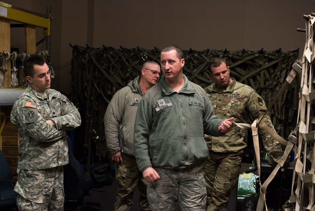 U.S. Air Force Master Sgt. Chad Stoulil, 55th Logistics Readiness Squadron Small Aircraft Terminal superintendent, teaches a cargo preparation course to Soldiers from the U.S. Army Reserve 561 st Regional Support Group at Offutt Air Force Base, Nebraska, Jan. 29, 2018. To prepare for joint operations in deployed environments, the Soldiers learned the details of effective and safe pallet building for air shipments. (U.S. Air Force photo by Senior Airman Jacob Skovo)