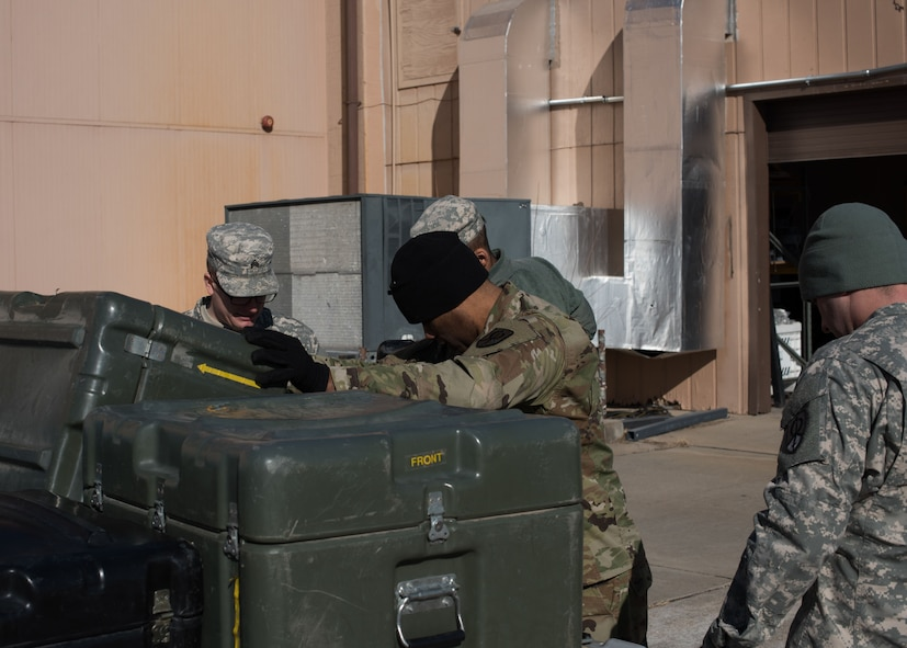 Soldiers from the U.S. Army Reserve 561st Regional Support Group, build a baggage pallet during a cargo preparation course at Offutt Air Force Base, Nebraska, Jan. 29, 2018. To prepare for joint operations in deployed environments, the Soldiers learned the details of effective and safe pallet building for air shipments. (U.S. Air Force photo by Senior Airman Jacob Skovo)