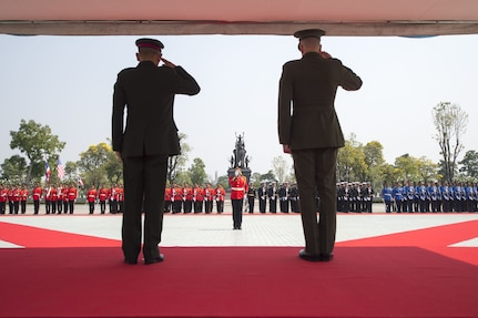 Marine Corps Gen. Joe Dunford, chairman of the Joint Chiefs of Staff, renders honors with Thai Army Gen. Tarnchaiyan Srisuwan, chief of the Defense Force, at the Royal Thai Armed Forces Headquarters in Bangkok, Feb. 7, 2018.