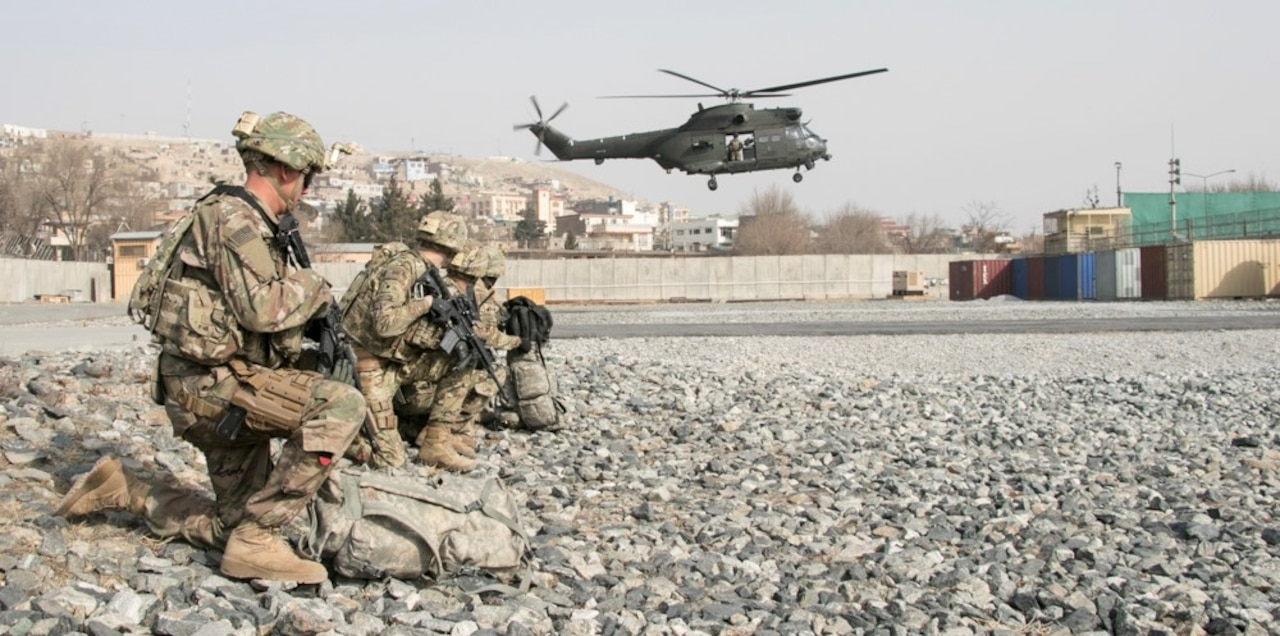 U.S. and British coalition partners and Afghan security forces train together in an aerial reaction force exercise utilizing British helicopter assets at Camp Qargha in Kabul, Afghanistan.