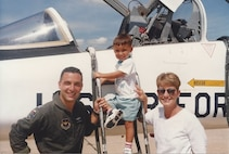 Long before Chris Mirarchi (center) was old enough to chase his own flying dream, he exhibited an affinity for the accoutrements of flight, like his dad. Here Lt. Col. Joe Mirarchi, his wife Teresa and Chris pose in front of dad's airplane at Reese Air Force Base, Texas following Joe's active duty fini flight.