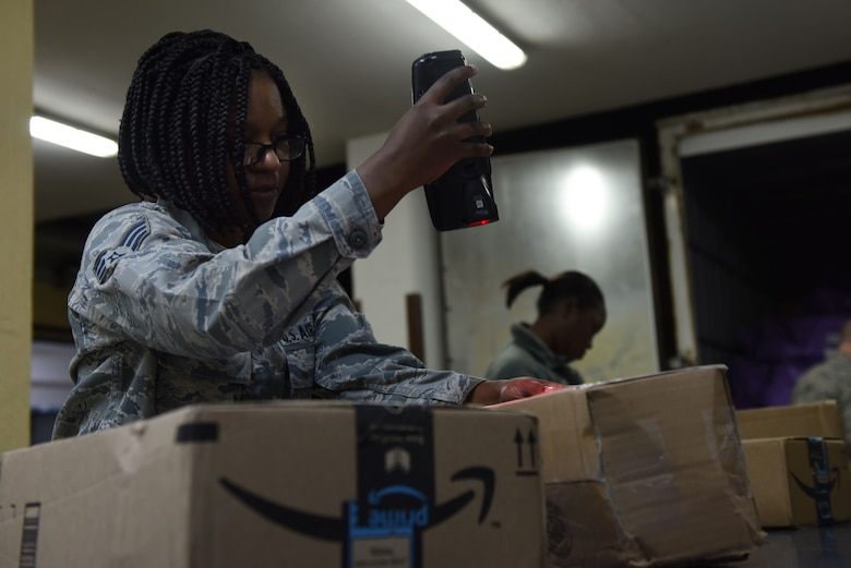 U.S. Air Force Senior Airman Krystal McDonald, 39th Communications Squadron postal clerk, scans a package at Incirlik Air Base, Turkey, Jan. 16, 2018.