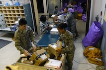 The 39th Communications Squadron postal clerks unload packages at Incirlik Air Base, Turkey, Jan. 16, 2018.