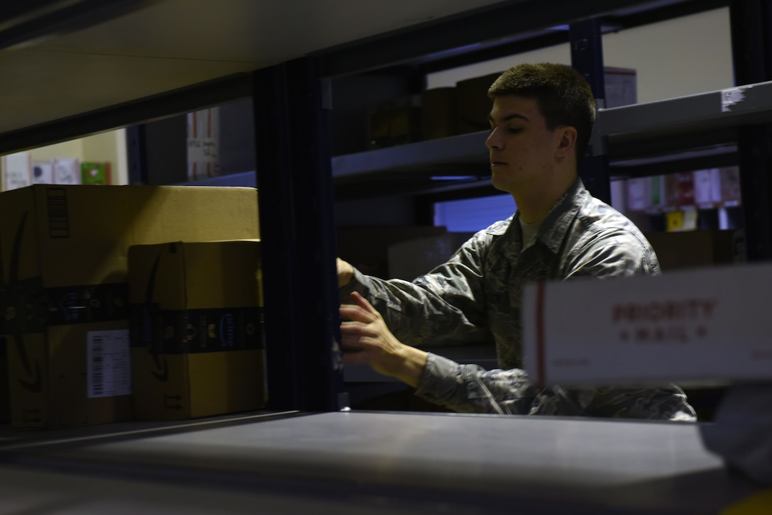 U.S. Air Force Airman 1st Class Ian Adair, 39th Communications Squadron postal clerk, places parcel packages on shelves at Incirlik Air Base, Turkey, Jan. 16, 2018.