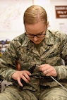 U.S. Air Force Airman 1st Class Ily Kendall, 39th Communications Squadron cyber transport systems technician, fabricates an ethernet cable at Incirlik Air Base, Turkey, Jan. 16, 2018.