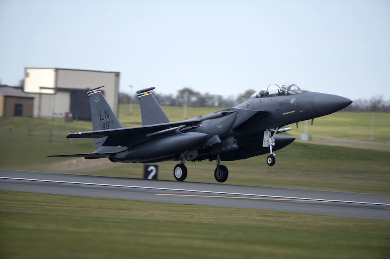An F-15E Strike Eagle flying the colors of multiple 48th Fighter Wing squadrons takes off from Royal Air Force Lakenheath, England, Feb. 6, 2018. The array of colors identifies it as the 48th FW commander's aircraft.  An array of avionics and electronics systems gives the F-15E the capability to fight at low altitude, day or night, and in all weather. (U.S. Air Force photo/Senior Airman Malcolm Mayfield)