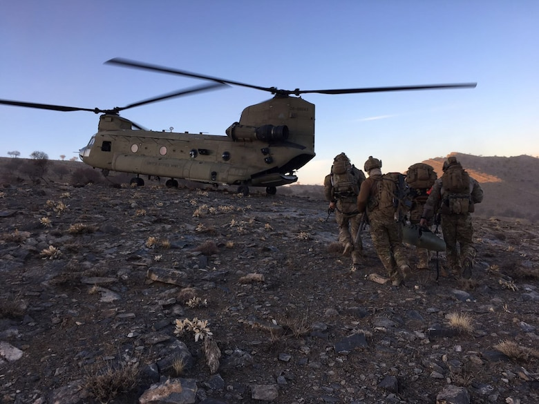 Members of the 83rd Expeditionary Rescue Squadron prepare to board a U.S. Army CH-47 Chinook at an undisclosed location in Afghanistan The 83rd ERQS, made up of Army Chinook crews and Air Force Guardian Angel teams, provide Air Force Central Command with a combat search and rescue capability.