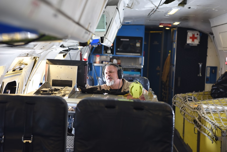 Lyn Lohberger, NASA Armstrong flight research center safety technician, checks diagnostics of the aircraft midflight, Jan. 31, 2018. Lohberger is a contractor for NASA and has been employed by them for 11 years.