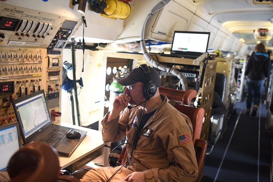 Adam Webster, NASA Armstrong flight research center mission director, monitors contrail emissions and flight patterns midflight Jan. 31, 2018. Webster aided in finding aircraft that were in the area so his pilots could request to monitor their emissions from behind.