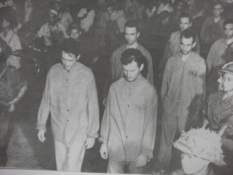 "Prisoners of war are marched in a Vietnamese prison camp during the Vietnam War. One prisoner, retired Col. Carlyle ""Smitty"" Harris was shot down April 4, 1965, during a bombing run targeting the Thanh Hoa Bridge. (Courtesy photo)"