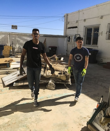 U.S. Marine Corps Cpl. Isaac D. Martinez and Lance Cpl. Joel Soriano, both strategic communication specialists with to Marine Corps Air Station (MCAS) Yuma's Headquarters & Headquarters Squadron, volunteer their Saturday to tear down a shed at St. Thomas Yuma Indian Mission in Winterhaven, Calif., Feb. 3, 2018. The mission, located out in the local Yuma community, requested help in tearing down the shed so that renovations could be made to the building. (U.S. Marine Corps photo taken by Cpl. Isaac Martinez)