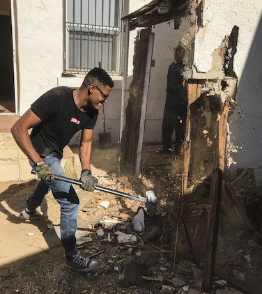 U.S. Marine Corps Cpl. Isaac D. Martinez, a strategic communication specialist assigned to Marine Corps Air Station (MCAS) Yuma's Headquarters & Headquarters Squadron, helps knock down part of a shed at St. Thomas Yuma Indian Mission in Winterhaven, Calif., Feb. 3, 2018. The mission, located out in the local Yuma community, requested help in tearing down the shed so that renovations could be made to the building. (U.S. Marine Corps photo taken by Lance Cpl. Joel Soriano)