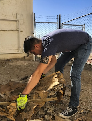U.S. Marine Corps Lance Cpl. Joel Soriano, a strategic communication specialist assigned to Marine Corps Air Station (MCAS) Yuma's Headquarters & Headquarters Squadron, lifts rubble from a torn-down shed at St. Thomas Yuma Indian Mission in Winterhaven, Calif., Feb. 3, 2018. The mission, located out in the local Yuma community, requested help in tearing down the shed so that renovations could be made to the building. (U.S. Marine Corps photo taken by Cpl. Isaac Martinez)