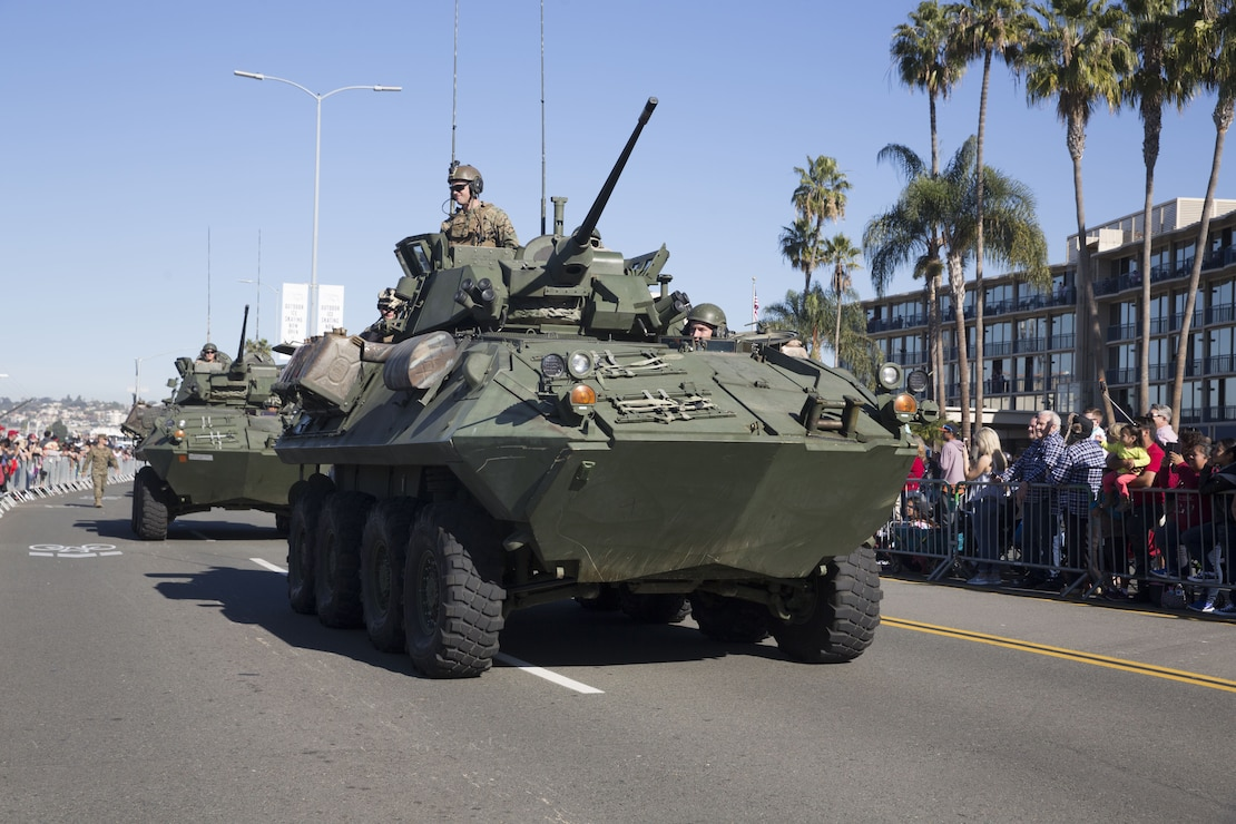 Marines with I Marine Expeditionary Force drive light armored vehicles by cheering crowds during the San Diego County Credit Union Holiday Bowl Parade, in San Diego, Dec. 28, 2017. In 2017, I MEF Marines and Sailors supported more than 140 community events.