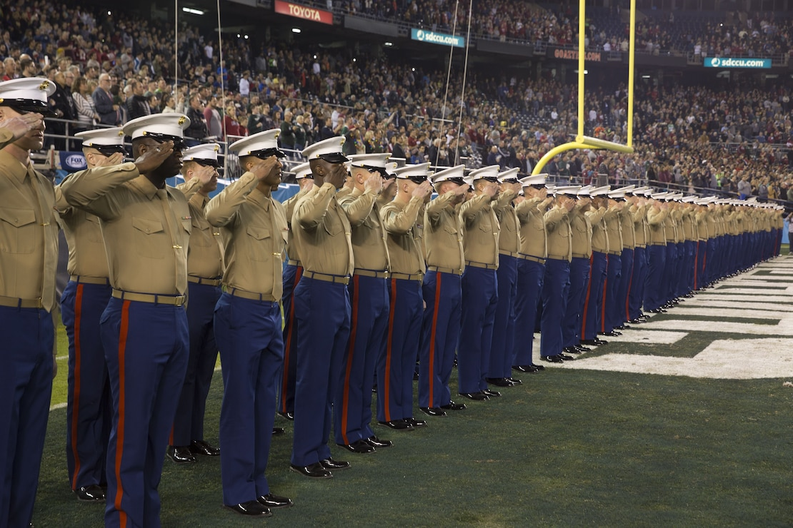 Marines and sailors with I Marine Expeditionary Force salute the flag during the San Diego County Credit Union Holiday Bowl National Anthem, Dec. 28, 2017. In 2017, I MEF Marines and Sailors supported more than 140 community events.