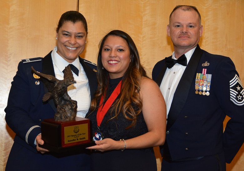 Col. Dana Nelson, 507th Air Refueling Wing vice commander, and Chief Master Sgt. David Dickson, 507th ARW command chief, present the 507th ARW Spouse of the Year award to Mrs. Jennifer Smith, Feb. 3, 2018, in Midwest City, Okla. (U.S. Air Force photo/Tech. Sgt. Samantha Mathison)