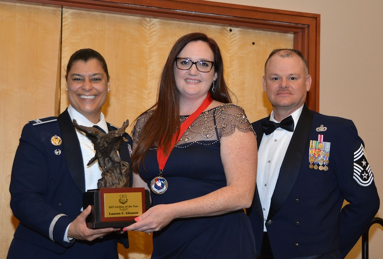 Col. Dana Nelson, 507th Air Refueling Wing vice commander, and Chief Master Sgt. David Dickson, 507th ARW command chief, present the 507th ARW Civilian  of the Year award to Mrs. Lauren Gleason, 507th ARW Public Affairs, Feb. 3, 2018, in Midwest City, Okla. (U.S. Air Force photo/Tech. Sgt. Samantha Mathison)