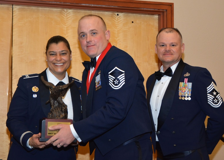 Col. Dana Nelson, 507th Air Refueling Wing vice commander, and Chief Master Sgt. David Dickson, 507th ARW command chief, present the 2017 507th ARW Senior Noncommissioned Officer of the Year award to Master Sgt. Ricky Buettner, 507th Security Forces Squadron, Feb. 3, 2018, in Midwest City, Okla. (U.S. Air Force photo/Tech. Sgt. Samantha Mathison)