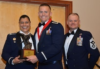 Col. Dana Nelson, 507th Air Refueling Wing vice commander, and Chief Master Sgt. David Dickson, 507th ARW command chief, present the 507th ARW Company Grade Officer of the Year award to 2nd Lt. Ryan Cheney, 507th SFS, Feb. 3, 2018, in Midwest City, Okla. (U.S. Air Force photo/Tech. Sgt. Samantha Mathison)