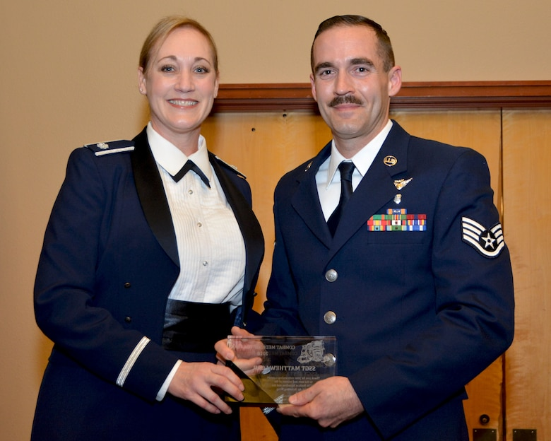 Lt. Col. Kim Vaillancourt, 507th Medical Squadron commander,  presents the 2017 507th MDS Combat Medic of the Year award for outstanding performance to Staff Sgt. Matthew Loar, 507th MDS, Feb. 3, 2018, Midwest City, Okla. (U.S. Air Force photo/Tech. Sgt. Samantha Mathison)
