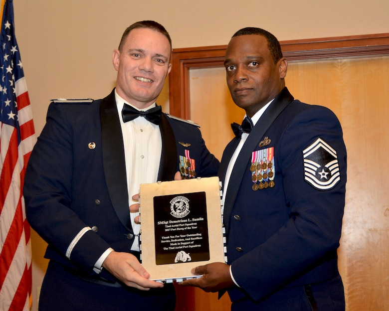 Lt. Col. Stan Young, 72nd Aerial Port Squadron commander, presents the 2017 72nd APS Port Dawg of the Year award for outstanding performance to Senior Master Sgt. Demetrious Sumlin, 72nd APS, Feb. 3, 2018, in Midwest City, Okla. (U.S. Air Force photo/Tech. Sgt. Samantha Mathison)