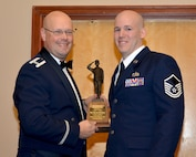 Col. Travis Caughlin, 507th Maintenance Group commander, presents the 2017 507th MXS Billy Hughes Memorial Award for outstanding performance to Master Sgt. Matthew Pearsall, 507th Aircraft Maintenance Squadron, Feb. 3, 2018, Midwest City, Okla. (U.S. Air Force photo/Tech. Sgt. Samantha Mathison)
