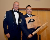 Chief Master Sgt. Nickolas Swainston, 507th Security Forces Squadron, presents the 2017 507th SFS Defender of the Year award for outstanding performance to Master Sgt. Hector Flores, 507th SFS, Feb. 3, 2018, in Midwest City, Okla. (U.S. Air Force photo/Tech. Sgt. Samantha Mathison)