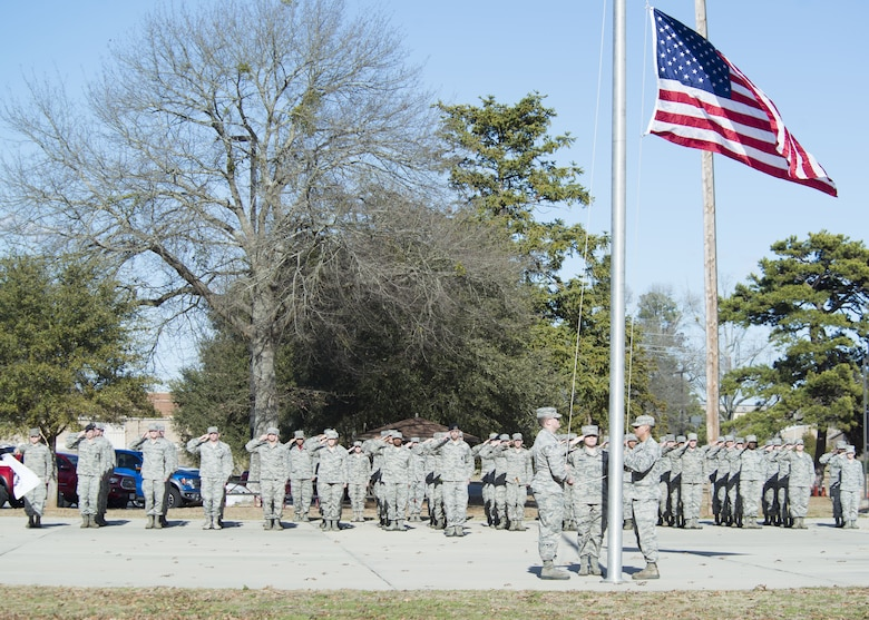 U.S. Airmen assigned to the Senior Master Sgt. David B. Reid Airmen Leadership School salute a flag at Shaw Air Force Base, S.C., Feb. 3, 2018.