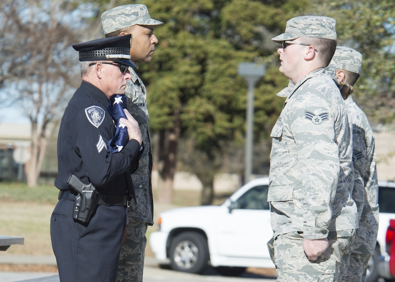 Gary Fowler, Sumter City Police Department emergency management coordinator, holds a flag presented by 20th Fighter Wing Airmen at Shaw Air Force Base, S.C., Feb. 2, 2018.
