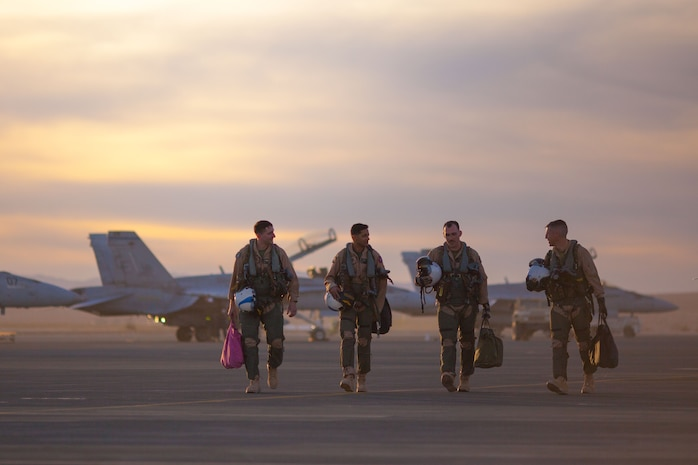 Marine pilots with Marine Fighter Attack Squadron All-Weather 225 walk off the Air Combat Element landing strip aboard the Marine Corps Air Ground Combat Center, Twentynine Palms, Calif., Jan. 29, 2018, as a part of Integrated Training Exercise 2-18. The purpose of ITX is to create a challenging, realistic training environment that produces combat-ready forces capable of operating as an integrated MAGTF.