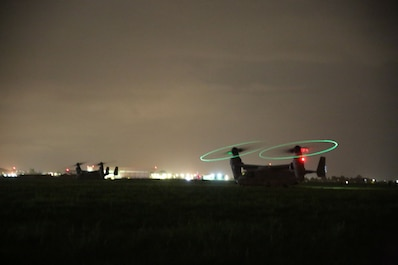U.S. Marine Corps MV-22B Ospreys prepare to take off during an alert force rehearsal conducted by Marines assigned to Special Purpose Marine Air-Ground Task Force-Crisis Response-Africa aboard Naval Air Station Sigonella, Italy, Dec. 27, 2017. SPMAGTF-CR-AF is deployed to conduct limited crisis-response and theater-security operations in Europe and Africa. (U.S Marine Corps Photo by Lance Cpl. Patrick Osino)
