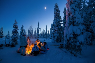 Participants of the Swedish Basic Winter Warfare Course rest and try to warm up in front of a fire during the course's culminating event in Arvidsjaur, Sweden, Jan. 23, 2018. Marines from the Black Sea Rotational Force and the 26th Marine Expeditionary Unit, along with troops from 9 other countries, participated in the Swedish Basic Winter Warfare Course. The course developed the participants' capability to survive in cold-weather environment, march on skis, apply his or hers tactical skills at individual and squad levels, and to lead smaller units in winter warfare in subarctic winter conditions. (U.S. Marine Corps photo by SSgt. Marcin Platek/Released)