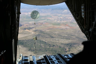 A load ejects from a U.S. Marine Corps KC-130J Hercules aircraft during Operation Death From Above, a bilateral training exercise with U.S. Marines assigned to Special Purpose Marine Air-Ground Task Force-Crisis Response-Africa and Spanish Armed Forces paratroopers, near Torrejón Air Base, Spain, Jan. 22, 2018. SPMAGTF-CR-AF is deployed to conduct limited crisis-response and theater-security operations in Europe and Africa. (U.S. Marine Corps Photo by Lance Cpl. Patrick Osino)