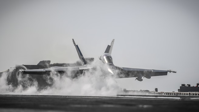 180206-N-MJ135-1243 ARABIAN GULF (Feb. 6, 2018) An F/A-18F Super Hornet, assigned to the Fighting Redcocks of Strike Fighter Attack Squadron (VFA) 22, launches from the flight deck of the aircraft carrier USS Theodore Roosevelt (CVN 71). Theodore Roosevelt and its carrier strike group are deployed to the U.S. 5th Fleet area of operations in support of maritime security operations to reassure allies and partners and preserve the freedom of navigation and the free flow of commerce in the region. (U.S. Navy photo by Mass Communication Specialist 3rd Class Spencer Roberts/Released)