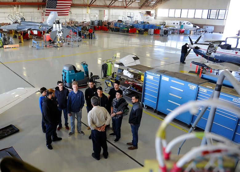 Larry Welfel, 12th Maintenance Squadron, T-1A aircraft technician, briefs Wagner high school students inside the phase inspection facility during the job shadow tour, Feb. 2, 2018, Joint Base San Antonio-Randolph, Texas.