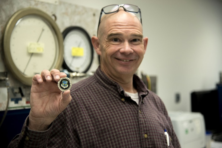 Dave McMillan, quality assurance evaluator for Kirtland's Precision Measurement Equipment Laboratory, was presented with an AFMETCAL Excellence Coin in recognition of his outstanding work as a quality assurance evaluator during a recent inspection.