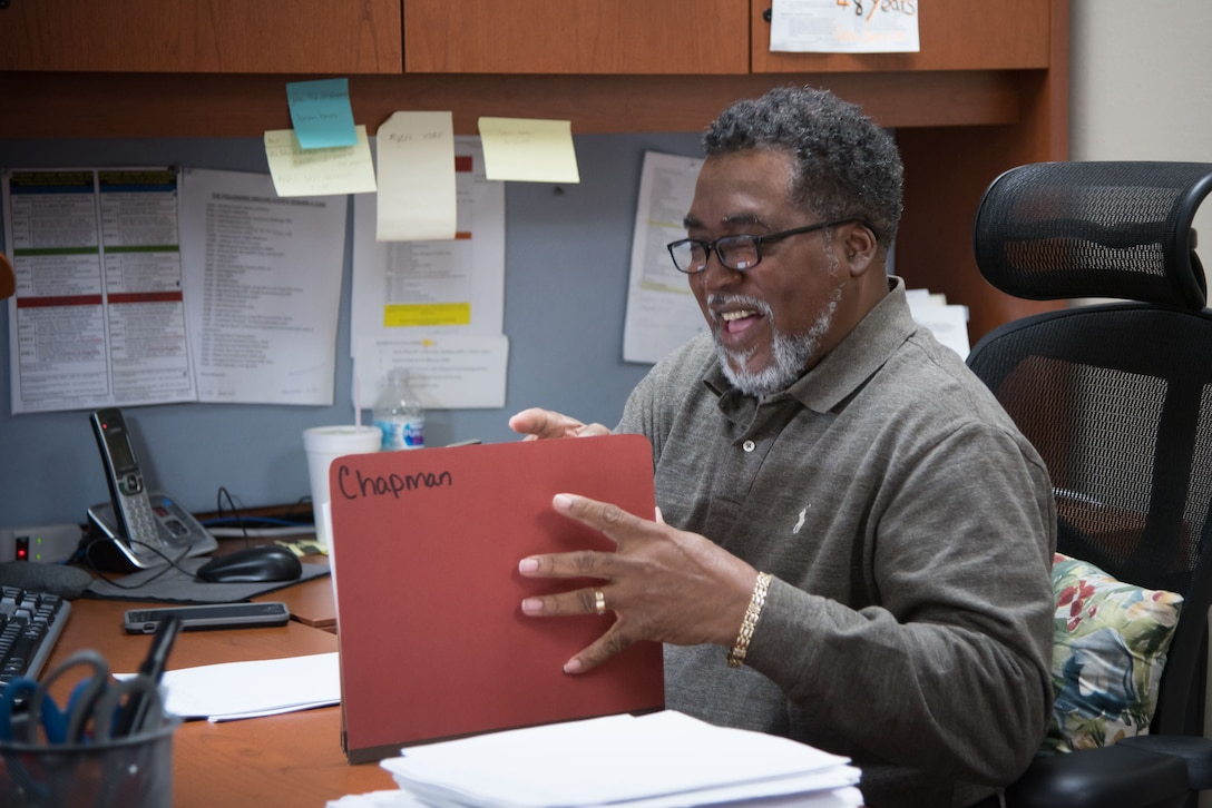 Gary Wallace, 53rd Weather Reconnaissance Sqadron aviation resource managment technician, checks squadron member personnel folders Jan. 29, 2018 at Keesler Air Force Base, Mississippi. Wallace retired Feb. 2, 2018 after more than 40 years of active duty and civil service to the Air Force. (U.S. Air Force photo by Staff Sgt. Heather Heiney)