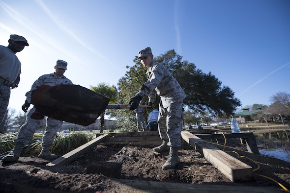 U.S. Air Force 2nd Lt. Stone Williford, 20th Civil Engineer Squadron real property specialist, removes dirt to level the ground at Shaw Air Force Base, S.C., Feb. 6, 2018.