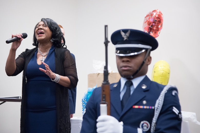 Catherine Brinson sings the National Anthem during a retirement ceremony for Gary Wallace, 53rd Weather Reconnaissance Squadron aviation resource management technician, Feb. 2, 2018 at Keesler Air Force Base, Mississippi. (U.S. Air Force photo by Staff Sgt. Heather Heiney)