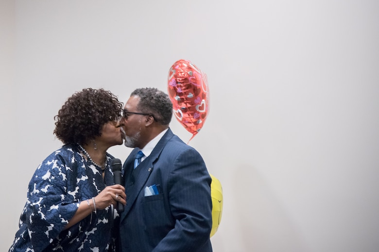YoLanda Wallace, 81st Mission Support Group, kisses her husband, Gary Wallace, 53rd Weather Reconnaissance Squadron aviation resources management technician, during his retirement ceremony Feb. 2, 2018 at Keesler Air Force Base, Mississippi. (U.S. Air Force photo by Staff Sgt. Heather Heiney)
