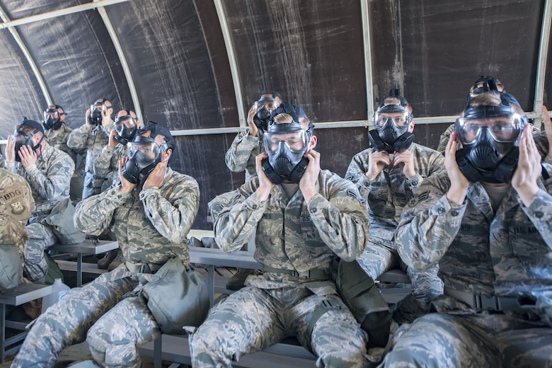 Airmen perform seal checks on their gas masks, Feb. 1, 2018, at Moody Air Force Base, Ga. Airmen participated in a chemical, biological, radiological and nuclear defense (CBRNE) class to better prepare them to combat enemy attacks while also familiarizing them with mission-oriented protective posture (MOPP) gear. (Air Force photo by Airman Eugene Oliver)